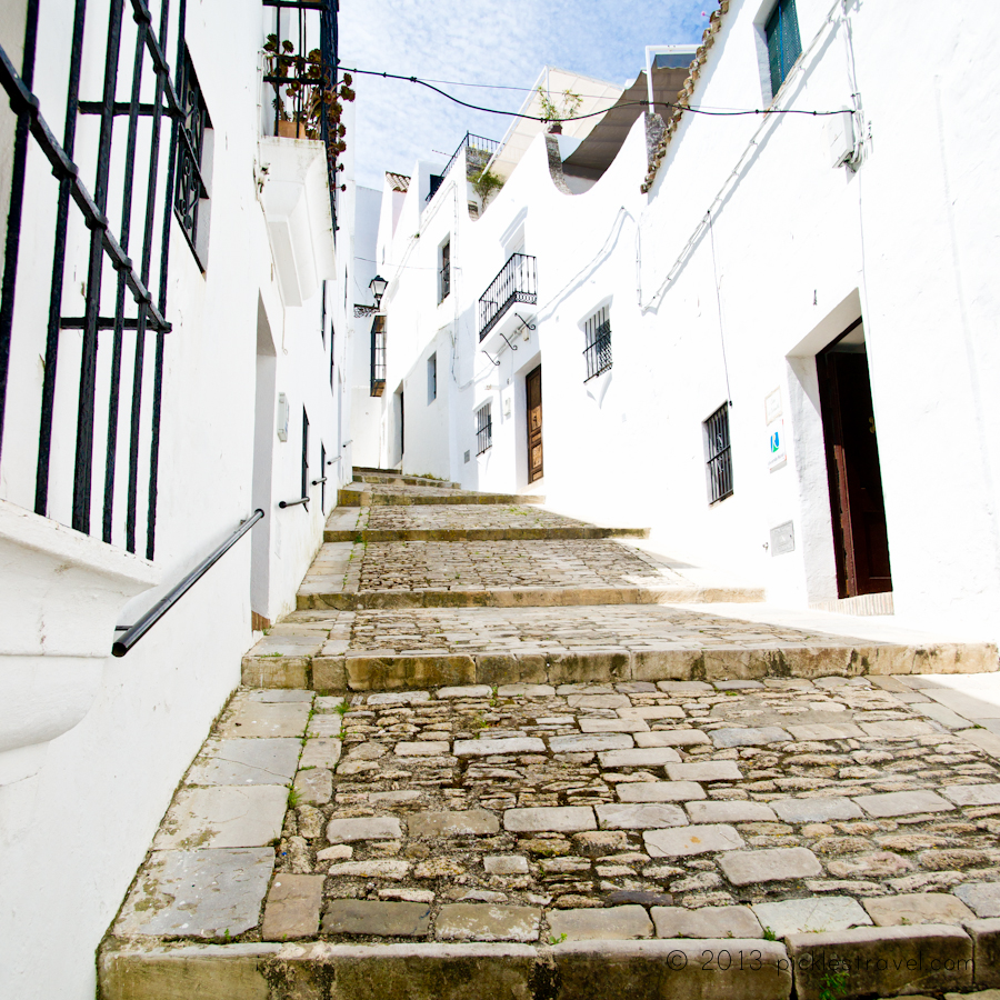 Cobblestone walks against white washed walls