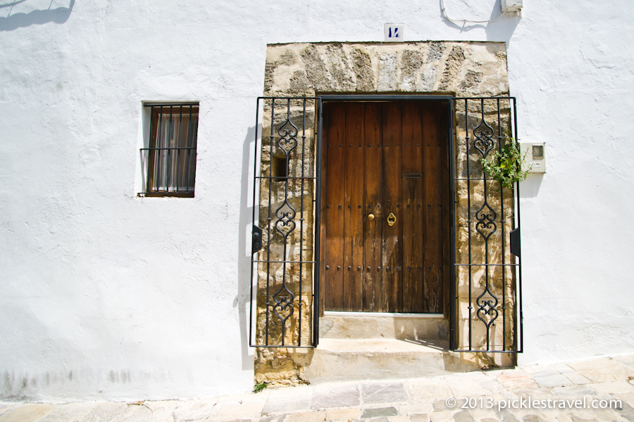 Doorway into a white home