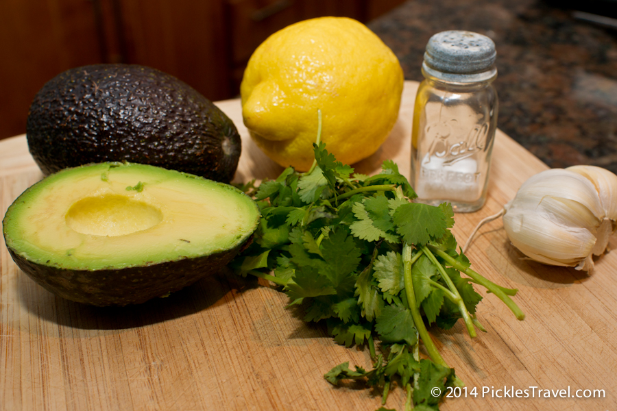 guacamole recipe ingredients: lemon, avocado, garlic, salt and cilantro