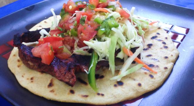 Ensalada repollo on a nicaraguan tortilla