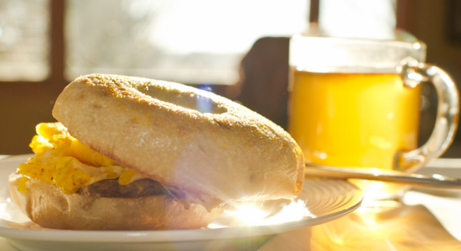 Happy sunny morning breakfast with egg bagel sandwich
