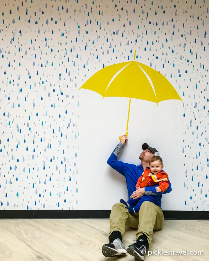 under the umbrella at Galleria Art Walls