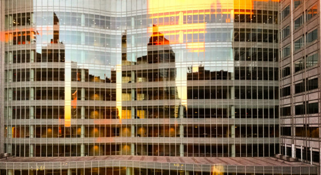 Rochester skyline reflected at sunrise in the Mayo Clinic